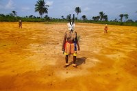 Karikpo At Oil Well Head © Zina Saro Wiwa